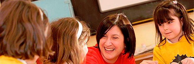 Image of kids with teacher laughing